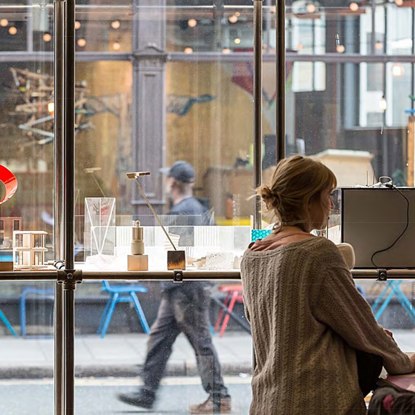 Woman at window bar at Squire and Partners