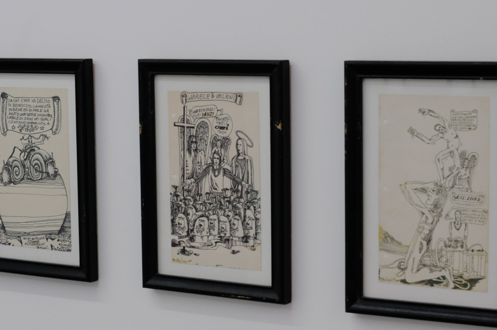 framed black and white illustrations hang on gallery wall