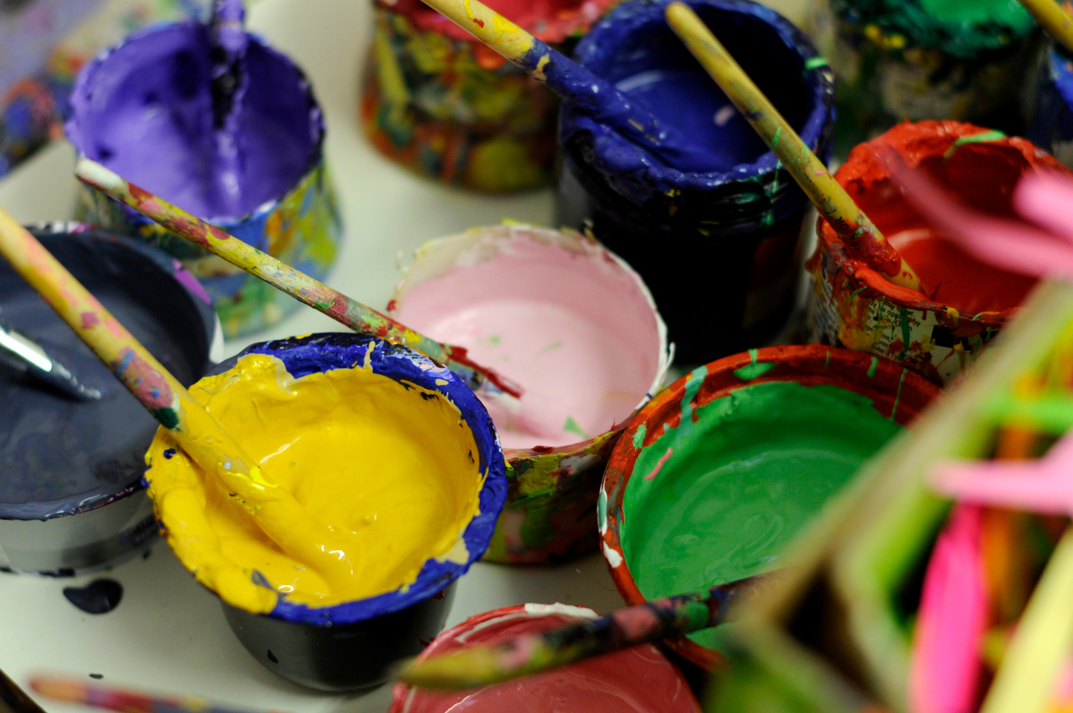 Image of colourful paint pots and brushes