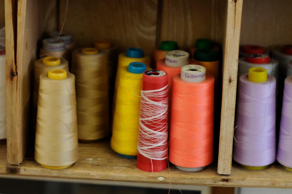 colourful cotton reels on shelf