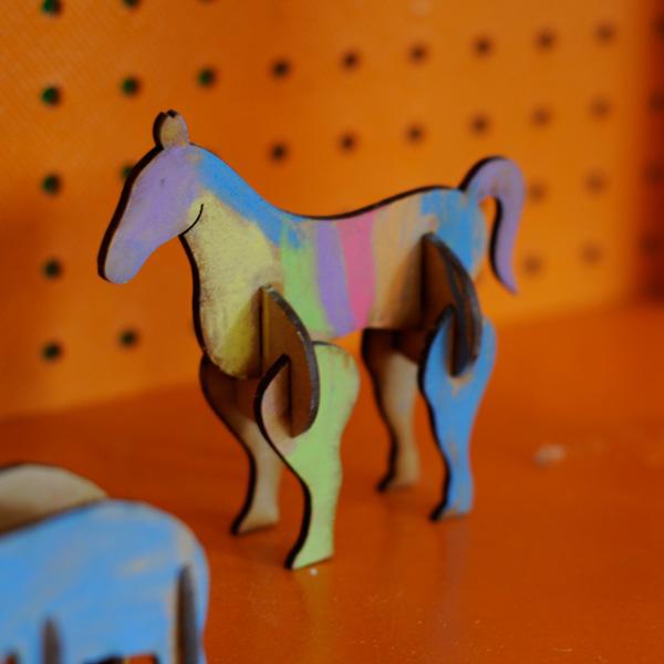 institute of imagination rainbow horses on orange background
