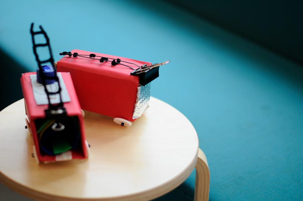 institute of imagination red trucks on stool
