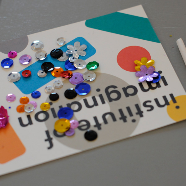 Institute of imagination postcard with buttons and sequins
