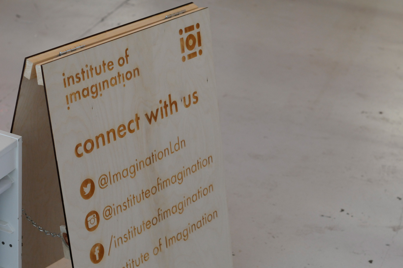institute of imagination wooden sign