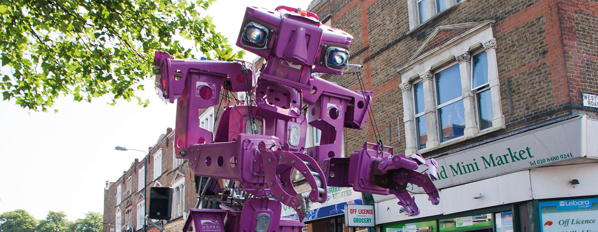 Purple rubbish machine giant puppet