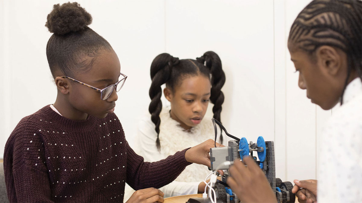 Children playing with construction materials at UK Black Tech